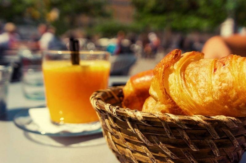 Croissants in a basket and juice