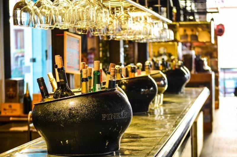 Champagne bottles in bulk on bar