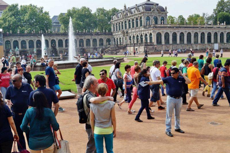 Groups of tourists at an attraction
