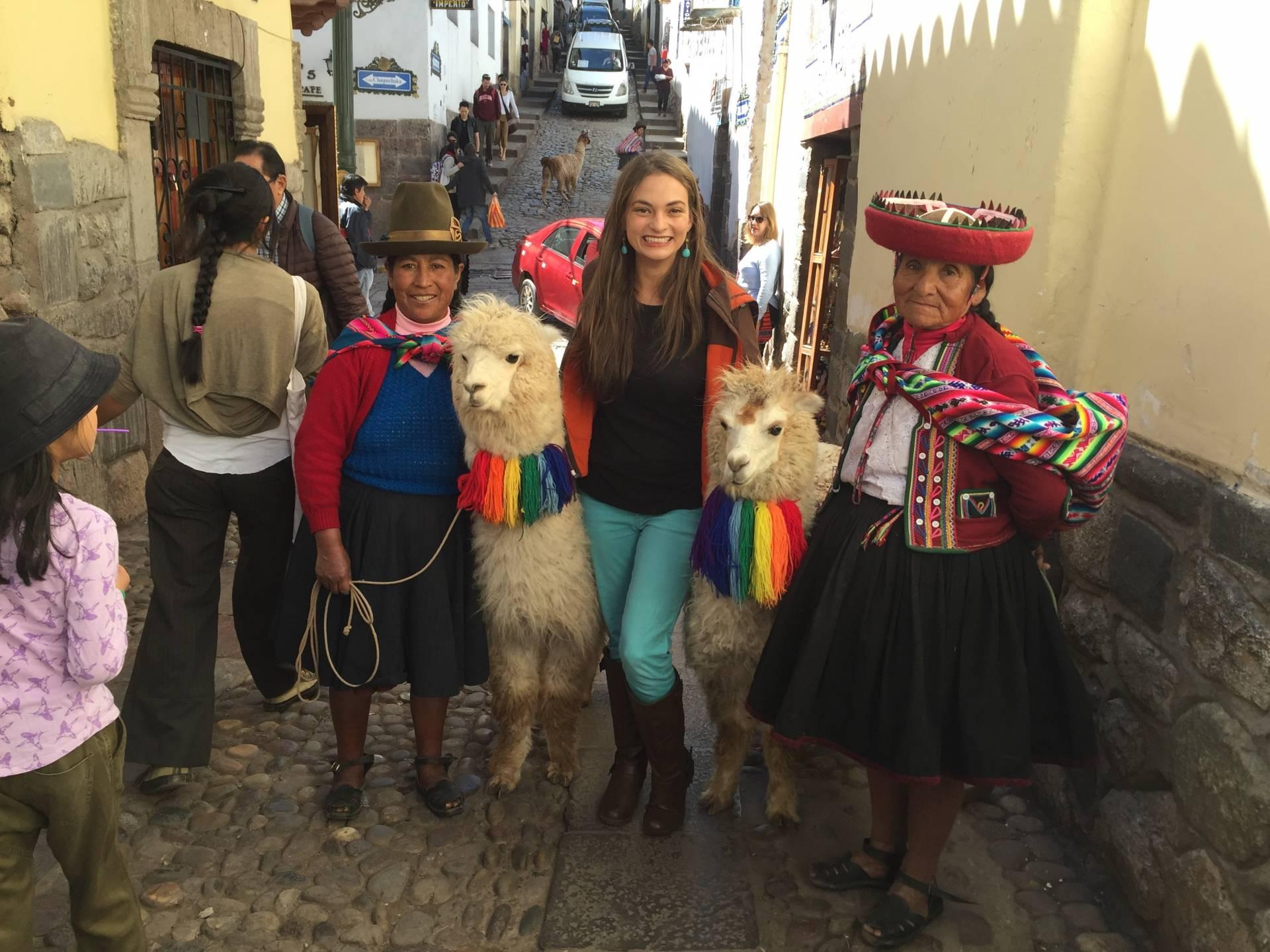 Posing with llamas in Cusco