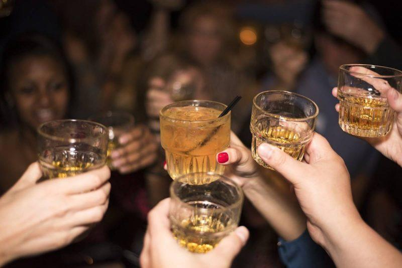 People toasting with shots