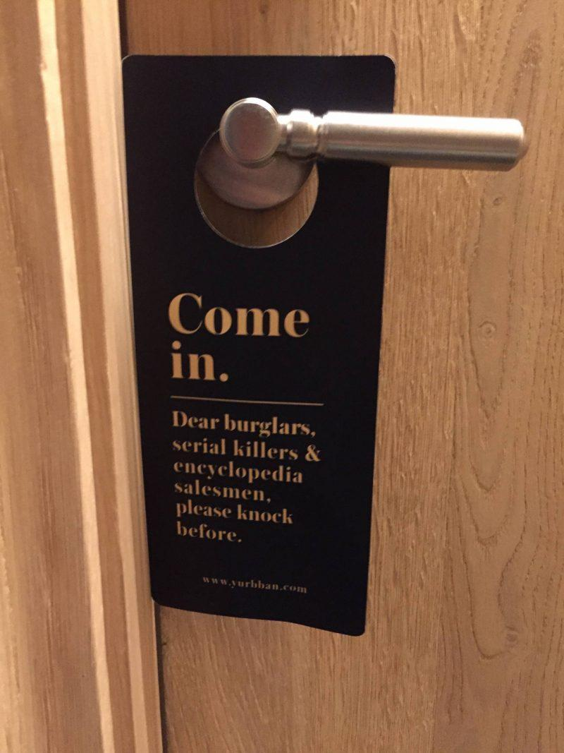 Funny door sign at a hotel in Barcelona