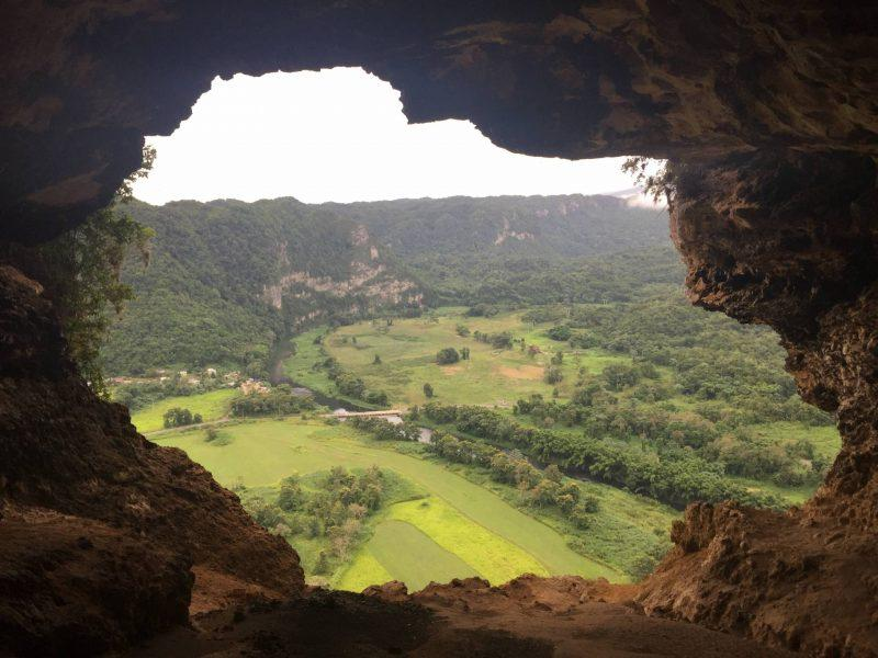 Cave opening overlooking fields
