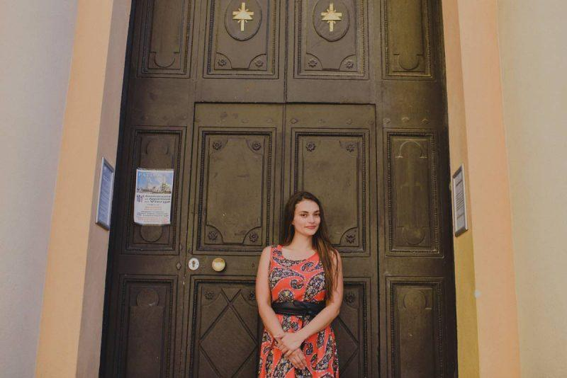 Posing in front of a church door