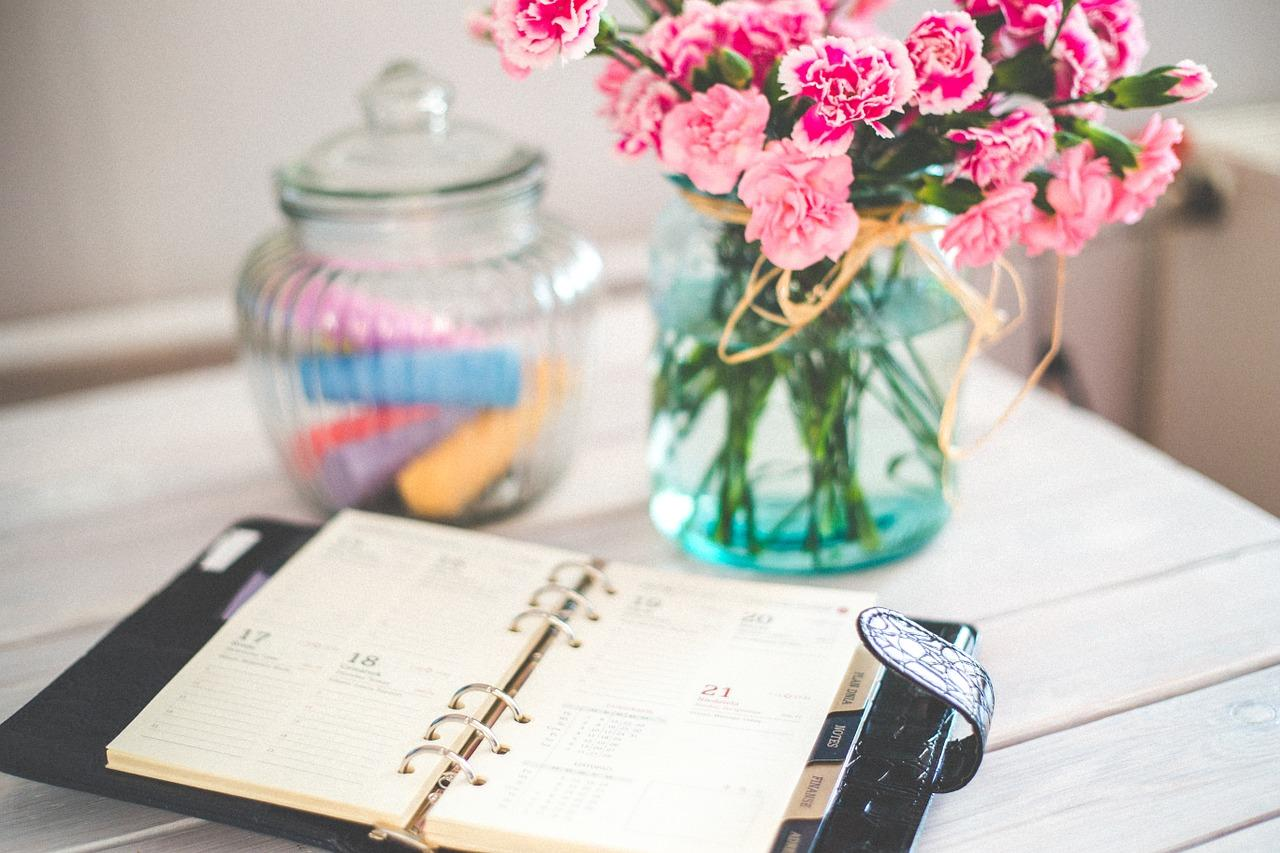 Day planner and flowers