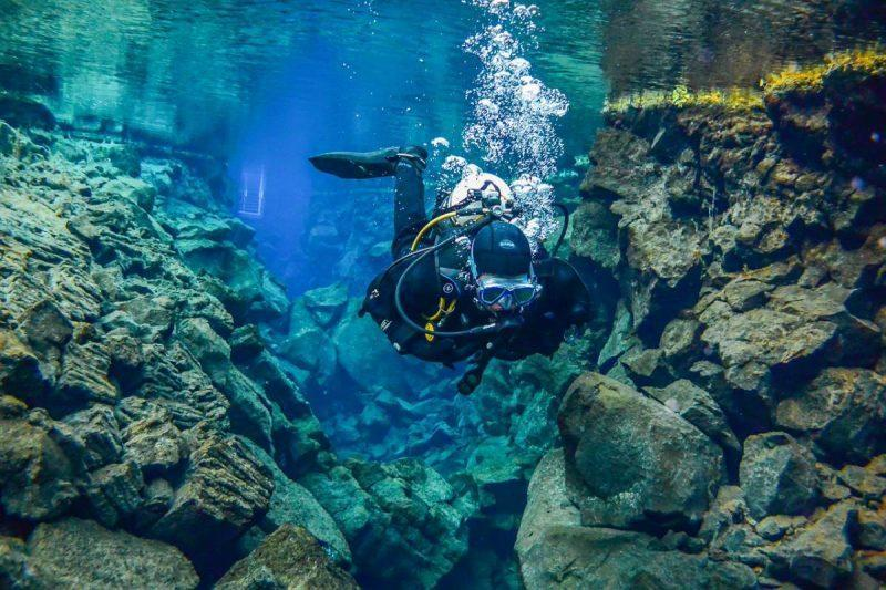 man diving in iceland