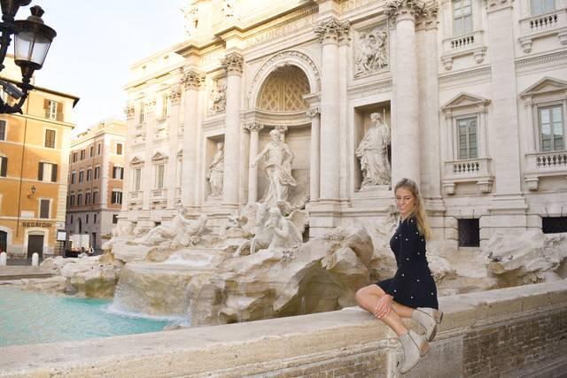 Posing by the Trevi Fountain