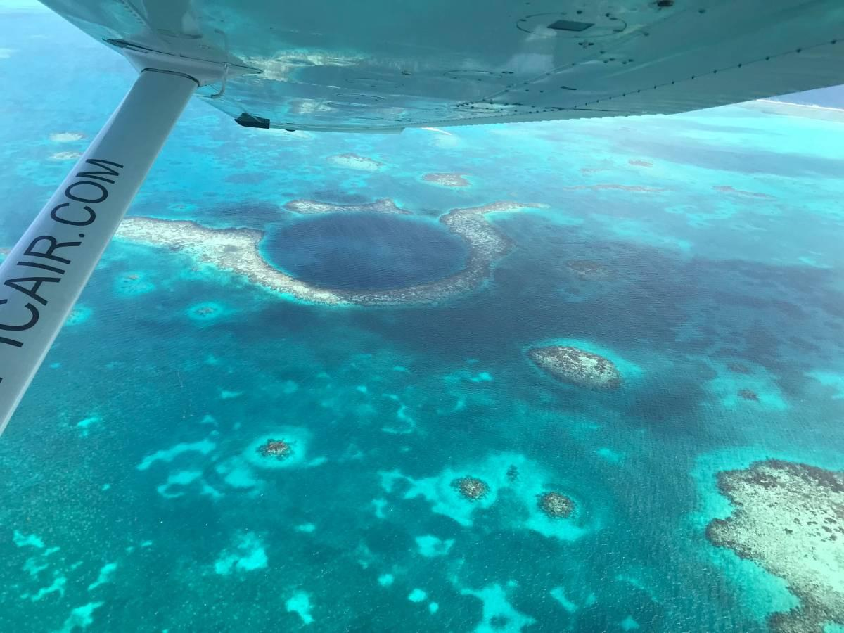 Taking a Scenic Flight Over the Great Blue Hole with Tropic Air Belize