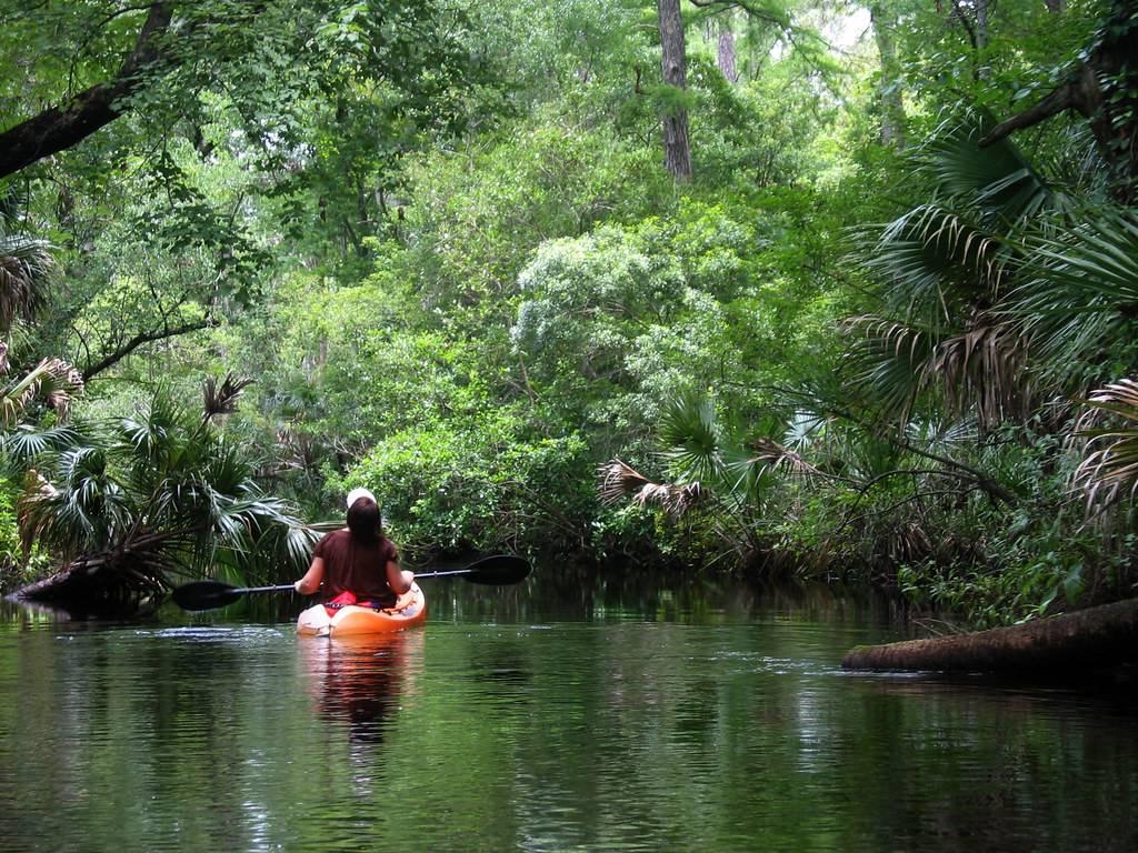 Woman kayaking alone