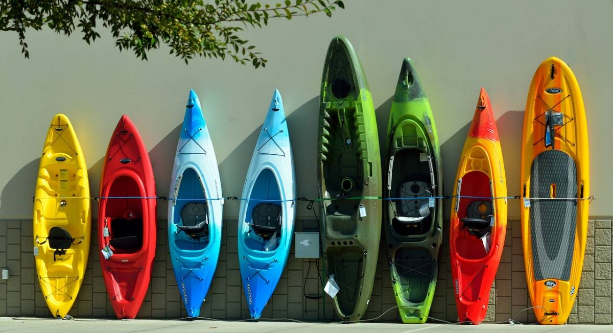 Colorful kayaks up against a wall