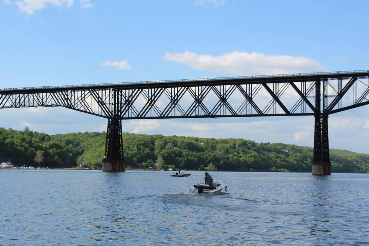 Man on a boat under the bridge