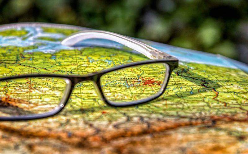 Glasses set on a map