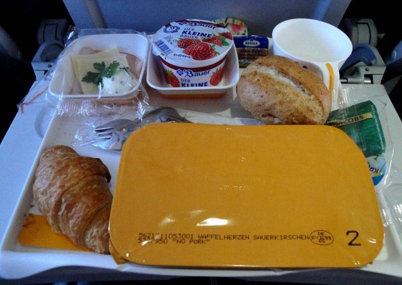 Tray filled with airline food