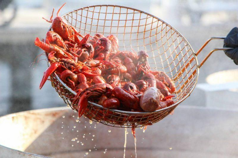 Crawfish being scooped out of boiling water