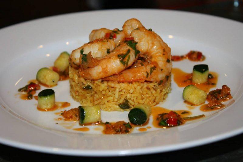 Rice and shrimp arranged on a plate