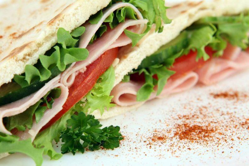 Club sandwich on a plate with paprika