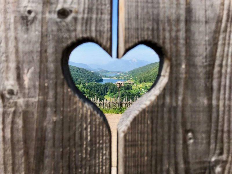 Wooden heart framing a landscape view of the surrounding nature