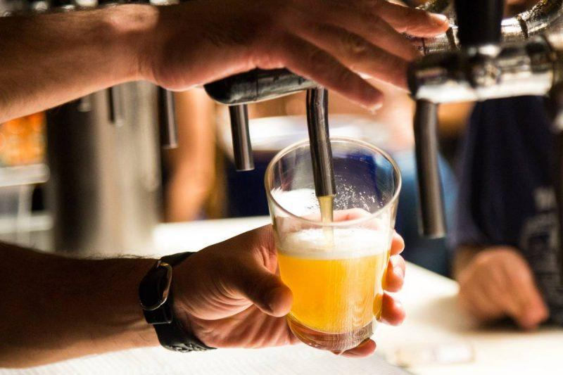 Bartender during beer from a tap