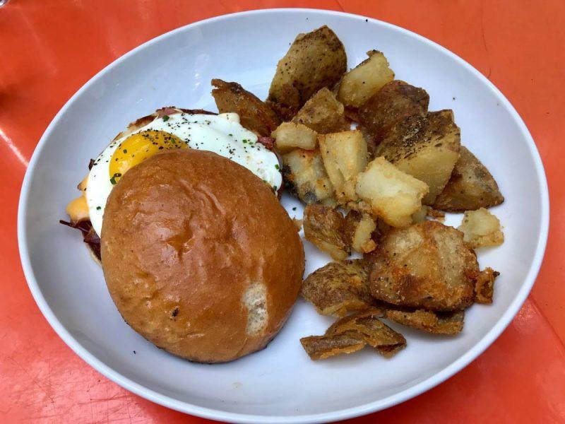 Breakfast sandwich and potatoes