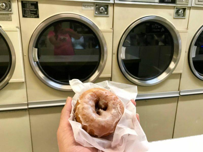 Donut in front of a washing machine