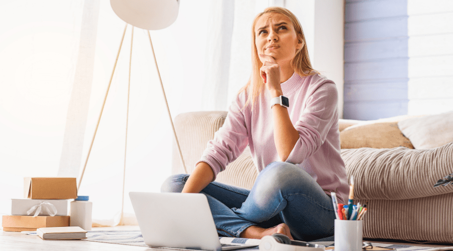 Woman contemplating while at laptop