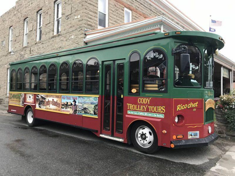 Green and red trolley thing to do in Cody WY