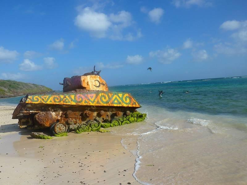 Decorated military tank on a beach