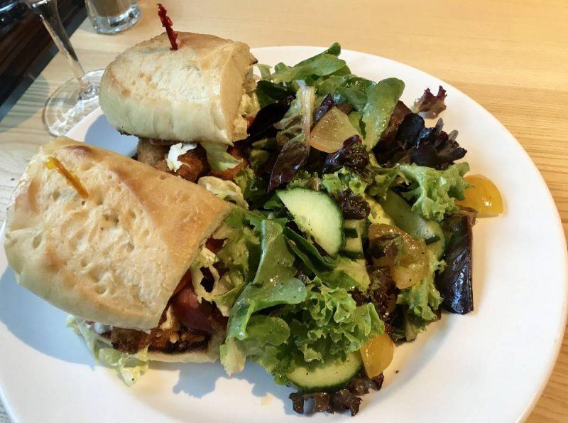 Shrimp po' boy sandwich and salad
