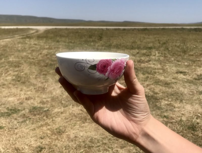 Holding a porcelain cup