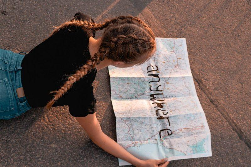 girl reading map