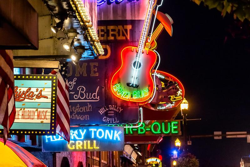 Honky tonk signs lit up at night