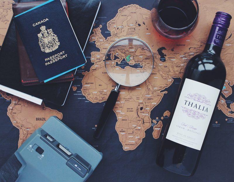 Map, passport and wine