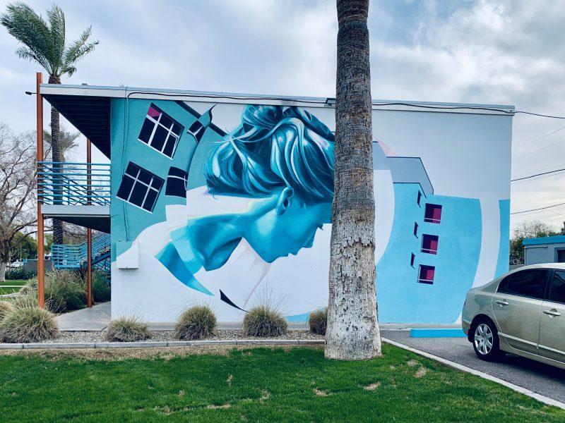 blue street art mural of a woman