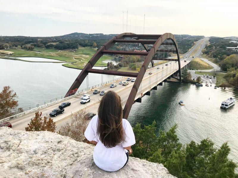 Sitting at the edge of Mount Bonnell