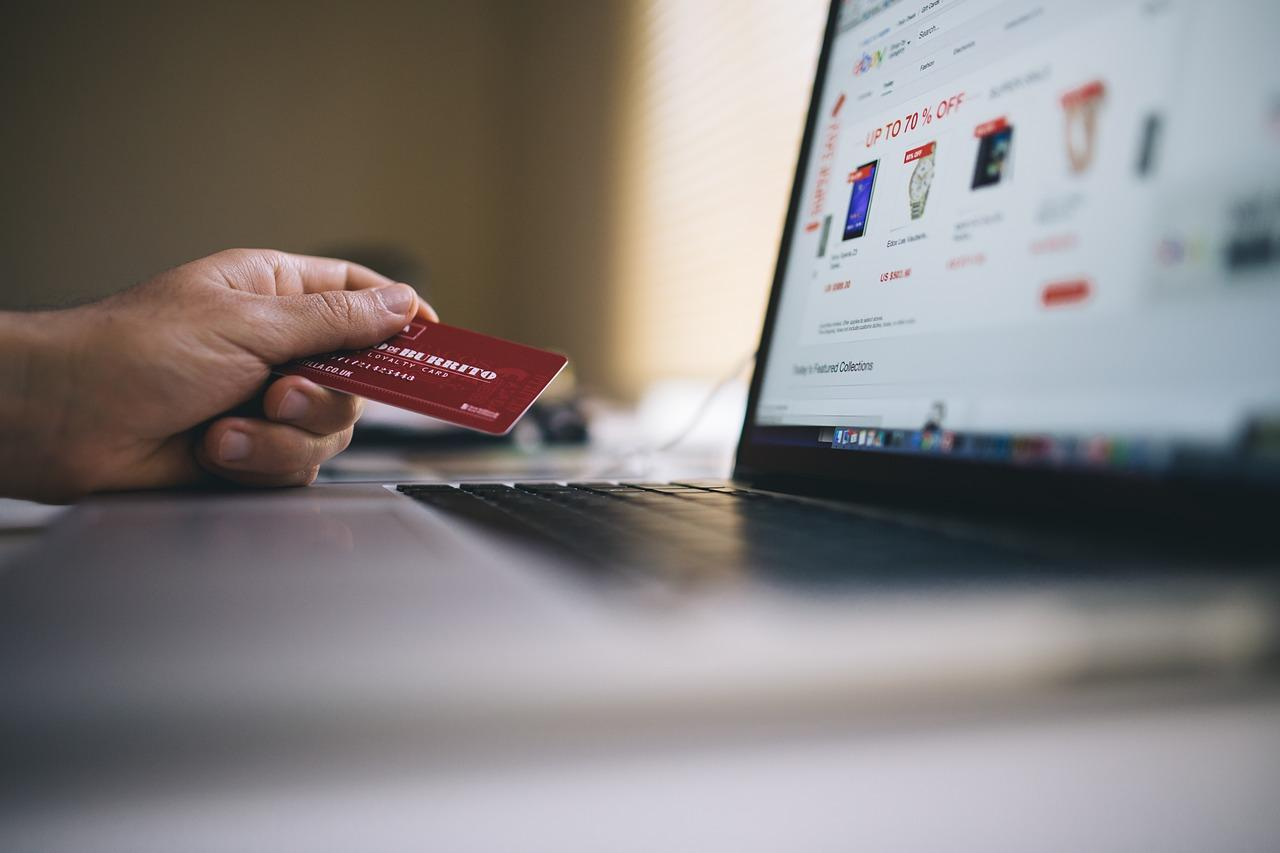 Man online shopping with credit card in hand