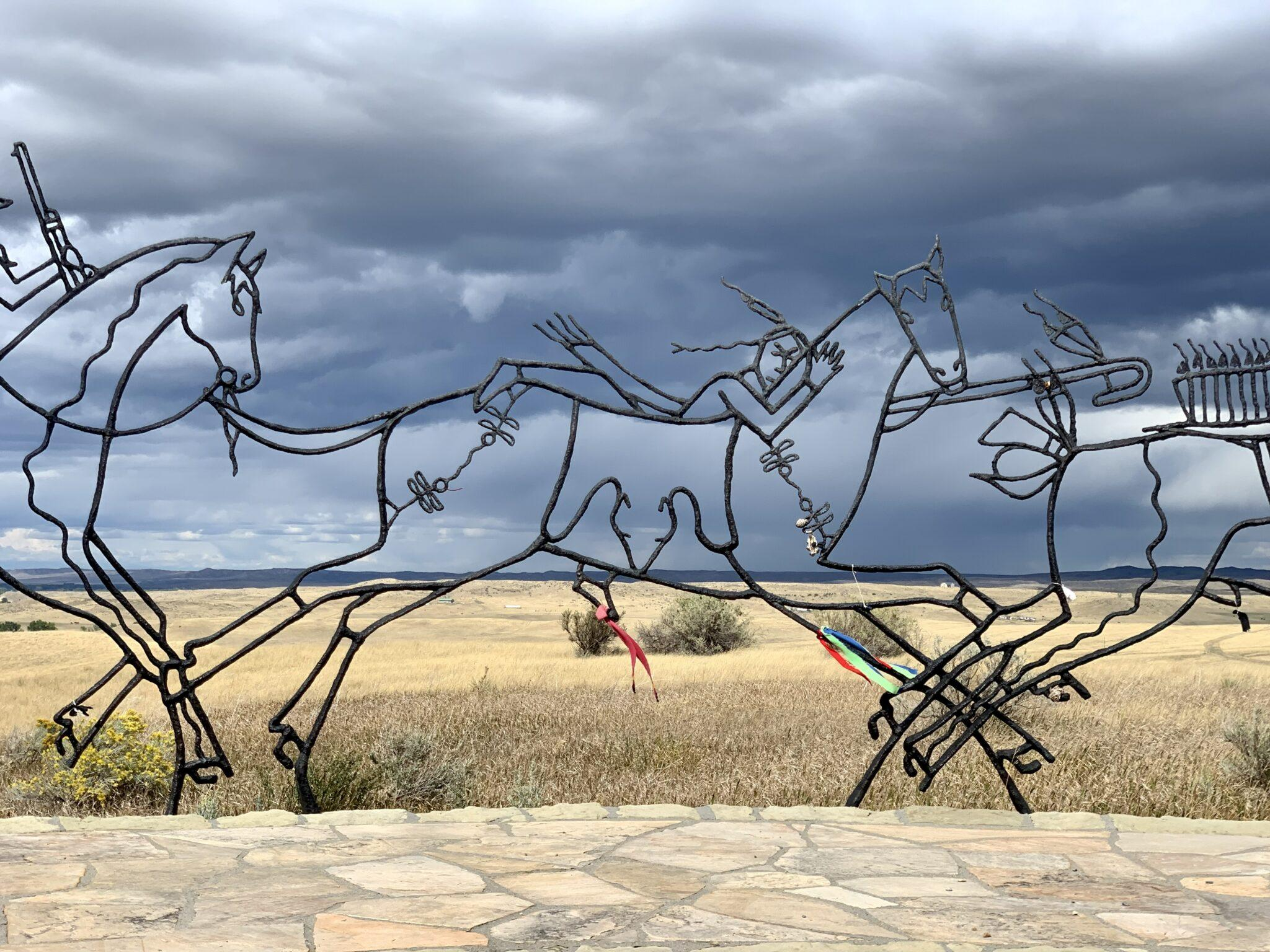 Statue of Indians on horses made of metal frame