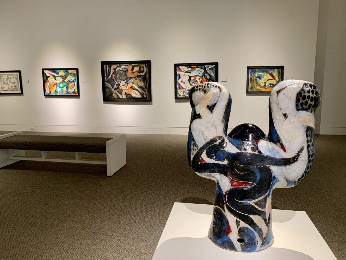 Sculpture and paintings in an indoor art gallery
